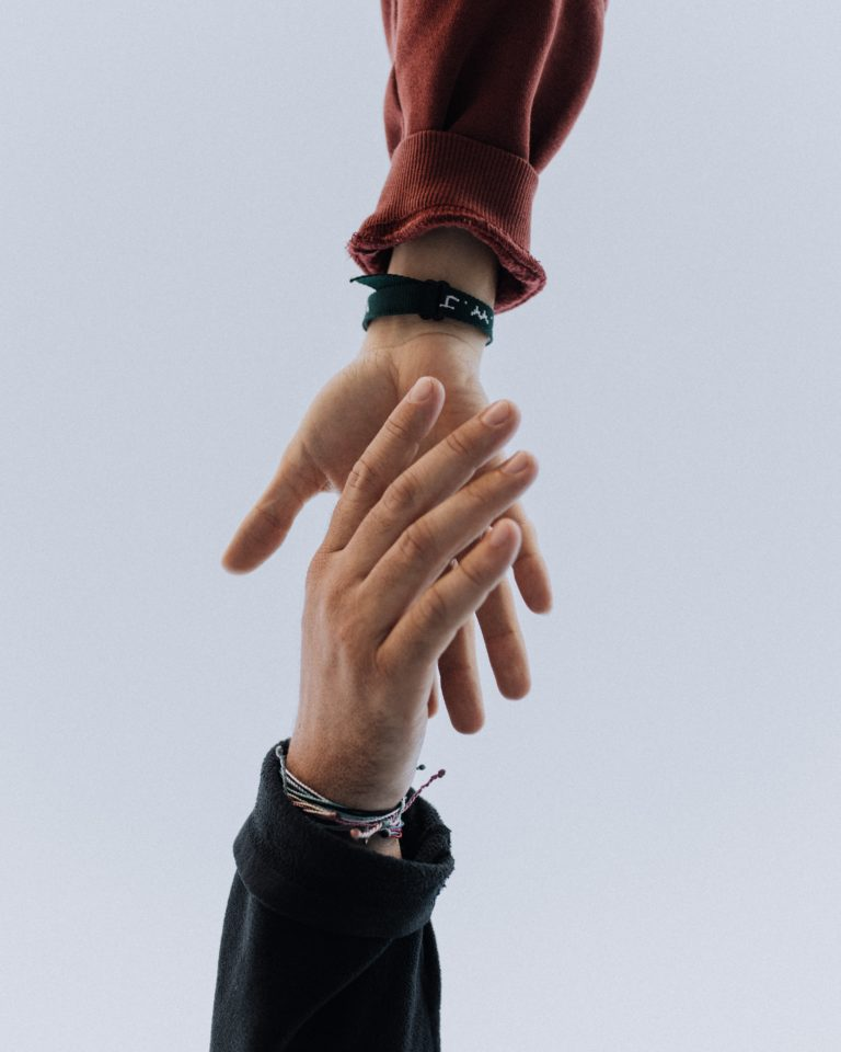 Hands reaching out to help each other