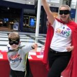 Adult and child dressed in superhero gear